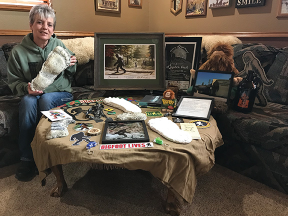Darlene Masters with her collection of Bigfoot memorabilia.