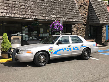 A Winlock police cruiser is parked on the street.